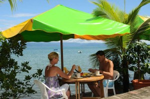 Having Breakfast at the Il Giardino Restaurant and Rooms Beachfront Tables in Puerto Jimenez, Osa peninsula